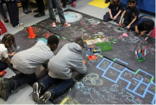 """Figure 2. Participants occupying a mock parking space for play and creation during the """"No Cars Go"""" lesson"""