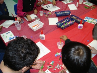 """Figure 3. Participants working on street art inspired mosaics during """"Tyndale Ti(l)es"""" lesson"""